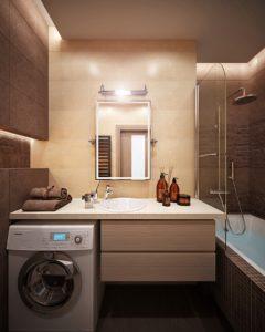 Стиральная машина в ванной комнате со столешницей из искусственного камня